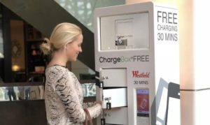 Woman using Westfield's charging station